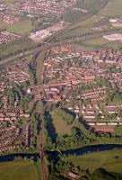 Aerial view of Uddingston looking east showing the viaduct (and former viaduct), station and junction.<br><br>[Ewan Crawford&nbsp;//1988]