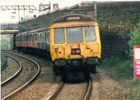 Different liveries obvious as this 311 is coupled to a 303a as it approaches Blairhill. Helensburgh Central is the destination.<br><br>[Brian Forbes&nbsp;//1988]