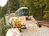 Ongoing construction work at Milton of Crathes on the Royal Deeside Railway in November 2006. View looking west towards Banchory with the preserved battery EMU alongside the platform.<br><br>[John Furnevel&nbsp;05/11/2006]