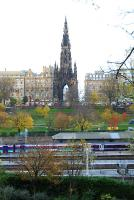 Waverley, the Scott Monument and a view over the Forth to Fife. Train in two liveries wait at the west end of the station.<br><br>[Ewan Crawford&nbsp;11/11/2006]