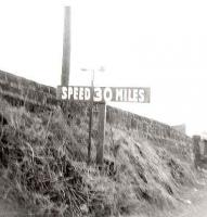 Speed restriction sign on the approach to Cartsburn Viaduct from Kilmacolm, pictured in 1967.<br><br>[John Gray&nbsp;//1967]