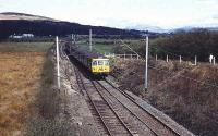 A 303 heads for Dumbarton along the recently singled line from Balloch just north of Dalreoch. The disconnected line is still in place. 15 April 1973.<br><br>[John McIntyre&nbsp;15/04/1973]