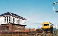 View of box, as a Cumbernauld to Springburn 101 passes the dividing home signal.<br><br>[Brian Forbes&nbsp;//1983]