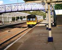 Merseyrail class 142 on its way home heads south through Dumfries in September 2006 after a works visit.<br><br>[John McIntyre&nbsp;22/09/2006]