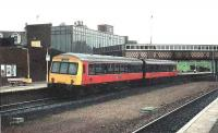 101 twin set pauses at Larbert bound for Glasgow.<br><br>[Brian Forbes&nbsp;//1991]