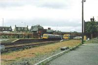 101s pass at Larbert, on the Dunblane/Edinburgh service. The far track is canted for speed.<br><br>[Brian Forbes&nbsp;//1984]