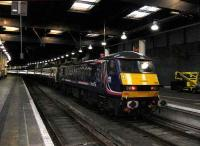 In Scotrail colours 90024 has brought in <i>The Royal Highlander</i> from Inverness with portions from Aberdeen and Fort William.<br><br>[Michael Gibb&nbsp;18/11/2006]