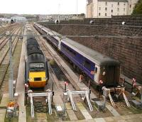 Mid morning scene at Clayhills sidings on Sunday 5 November 2006. The HST set will form the 1142 service to Kings Cross. Stabled alongside is the stock of the Aberdeen portion of the Caledonian Sleeper.<br><br>[John Furnevel&nbsp;05/11/2006]