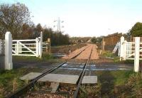 View west over Kincardine level crossing on 21 November 2006.<br><br>[John Furnevel&nbsp;21/11/2006]