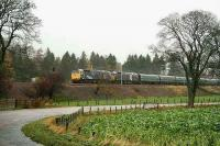 A pair of class 47s heads a Victa Railfreight service south near Lamington in November 2006. The stock consists of ex-Motorail vans used for the transport of cars.  <br><br>[John Furnevel&nbsp;03/11/2006]