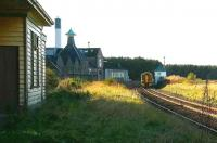 An afternoon Inverness - Aberdeen 158 service passing between Kennethmont signal box and Ardmore distillery in November 2006 on the approach to the former Kennethmont station, closed to passengers in May 1968.<br><br>[John Furnevel&nbsp;08/11/2006]