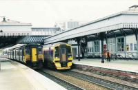 150261 calls at platform 3 with an Edinburgh local service. 158704 is an express for Aberdeen.<br><br>[Brian Forbes&nbsp;//1993]