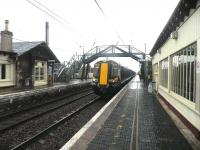 View east at Drem station on 16 August 2011 with a North Berwick - Edinburgh service at the platform.<br><br>[John Yellowlees&nbsp;16/08/2011]