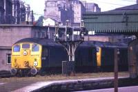 A pair of class 24s with 24125 leading and 24108 trailing pass northbound through Aberdeen platform 8 in July 1974. <br><br>[John McIntyre&nbsp;/07/1974]