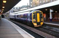 A First ScotRail 158 service to Dunblane. All part of the seemingly non-stop cavalcade through Haymarket platform 4, December 2006.<br><br>[John Furnevel&nbsp;/12/2006]