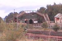 Portals of Aviemore shed 60B are framed under old footbridge at the Speyside station.<br><br>[Brian Forbes&nbsp;/09/2006]