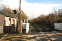 Looking east from the level crossing at Oyne over the site of the former station in 2006.<br><br>[John Furnevel&nbsp;08/11/2006]