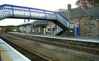 Looking south across the platforms at Inverurie in November 2006. The recent refurbishment and repainting work included the footbridge.<br><br>[John Furnevel&nbsp;06/11/2006]