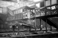 <I>Heave...!!!</I> Demolition of stairs on the northside walkway at Aberdeen in March 1973. The walkway leads to the former GNSR suburban booking office.<br><br>[John McIntyre&nbsp;/03/1973]