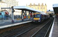 Work on the erection of the canopy over the new platform 0 at Haymarket underway on 11 December 2006, as a returning Fife Circle DMU leaves platform 1 for Waverley.<br><br>[John Furnevel&nbsp;11/12/2006]
