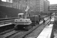 Aberdeen 1973. Looking north along platform 6 over the 4 through platforms (although the platform 7 line on which the digger is standing was truncated at the north end at that particular time).<br><br>[John McIntyre&nbsp;//1973]