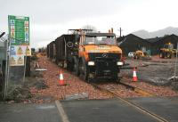 Ballast <I>train</I> at Cambus level crossing on 15 December looking west.<br><br>[John Furnevel&nbsp;15/12/2006]