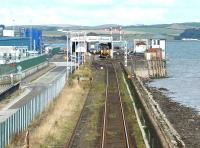View over Stranraer Harbour on a Sunday morning in the summer of 2003 with a train at the platform.<br><br>[John Furnevel&nbsp;17/08/2003]