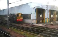 Wabtec shunter 08615 stands outside Craigentinny depot on 28 December. Grab shot from a passing train. <br><br>[John Furnevel&nbsp;28/12/2006]