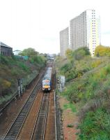 A service on the bidirectional track of the Cowlairs Incline which is overlooked by high flats.<br><br>[Ewan Crawford&nbsp;04/11/2006]