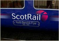 Side of First ScotRail North Berwick line unit no 322481 preparing to leave Edinburgh Waverley station for the east coast on 28 December 2006.<br><br>[John Furnevel&nbsp;28/12/2006]