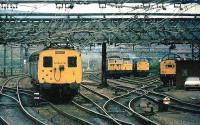 The holding sidings to the east of Guide Bridge station housed electric locomotives for use on trans-pennine freight via Woodhead. A Manchester bound DC electric service passes the sidings early in 1981 on the approach to Guide Bridge station. The Woodhead route was closed later that year.<br><br>[Ian Dinmore&nbsp;//1981]