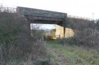 Overbridge to the west of Mawcarse station where the trackbed is crossed by the A911. View looks west. [With thanks to Brian McDevitt for correcting the details.]<br><br> [Railscot note: this bridge was on a re-alignment of the line from 1890, the opening of the Forth Bridge and Glenfarg line, to ease a curve here. The formation is still visible today and often mistaken for a station.]<br><br>[Brian Forbes&nbsp;01/01/2007]