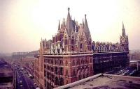 1970s view over the North London rooftops showing St Pancras station frontage and the trainshed straight ahead, with Kings Cross visible to the right.<br><br>[Ian Dinmore&nbsp;//]