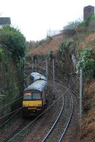 Helensburgh train heading west for the twin tunnels under Brucehill.<br><br>[Ewan Crawford&nbsp;05/01/2006]