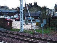 At one time there was a goods yard at Paisley Gilmour Street, which was situated at the same place as the car park and former Post Office. This shows the former entrance to it, which is now a track access point.<br><br>[Graham Morgan&nbsp;05/01/2007]