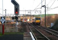 View east from the platform at Newton station on 5 January 2007. On the left is the WCML. In the centre a terminated service waits in the reversing siding at Newton East Junction pending its return to Glasgow. On the right a Milngavie train is approaching the station from Lanark. <br><br>[John Furnevel&nbsp;05/01/2007]