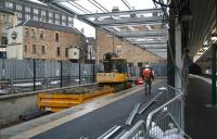 Looking towards the buffer stops along Haymarket's new platform 0 on 20 December 2006 with work on the canopy now underway. Haymarket tunnel can be seen at the end of platform 1 on the right and the doomed Caledonian Alehouse stands on the left. [See image 23206]   <br><br>[John Furnevel&nbsp;20/12/2006]