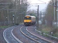 318258 heading up the hill on the approach to Johnstone station<br><br>[Graham Morgan&nbsp;09/01/2007]