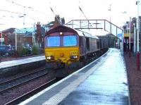 66242 with coal empties for Hunterston passing through Johnston station.<br><br>[Graham Morgan&nbsp;09/01/2007]