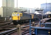 A pair of class 33s with a ballast train at Waterloo station in March 1976.<br><br>[John McIntyre&nbsp;19/03/1976]