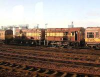 Pair of EWS shunters sidelined at Motherwell MPD. Seen from a passing train in January 2007.<br><br>[John Furnevel&nbsp;05/01/2007]