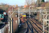 A Balloch train heads west at Sunnyside Junction, shortly after leaving Coatbridge Sunnyside station in January 2007. The line coming in bottom centre is from Whifflet South Junction and the partially lifted line heading off centre right under the bridge once ran to Gunnie Yard. On the left of the picture are some of the exhibits at the Summerlee Heritage Museum and on the horizon stand the cranes of Coatbridge Freightliner Terminal.<br><br>[John Furnevel&nbsp;/01/2007]