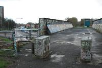 Looking east to Scotstoun West station. This fine girder bridge looks to be in a state of siege. Doocots abound round here.<br><br>[Ewan Crawford&nbsp;09/01/2006]