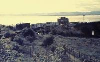 Sunset at Wormit, 1982. Equipment huts on northbound platform to the right of the surface bothy(with chimneys). The track and up platform are overgrown. <br><br>[Brian Forbes&nbsp;/10/1982]