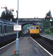 A class 33 on a northbound service arrives at Yeovil Pen Mill in 1985 while a DMU waits for the road down to Weymouth. <br><br>[John McIntyre&nbsp;//1985]