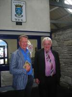 End of the line for Michael Portillo during the recording of <I>Great British Railway Journeys</I>, seen here at Wick with John Yellowlees in September 2012. [Editors note: The broad smiles are due to the pair having just discovered that they buy their shirts from the same website. (RailShirt.com)]<br><br>[John Yellowlees Collection&nbsp;/09/2012]