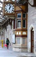 The bay window of Perth station's down centre signal box, and the famous clock are ignored by an intending passenger anxiously looking at the timetable in January 2007.<br><br>[Brian Forbes&nbsp;14/01/2007]