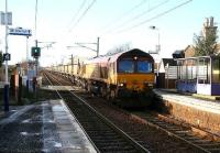 Fu-fur-fu-fur-fu-freezing cold morning at Kingsknowe on 25 January with the predominant sound being the crunch of shoes (mine) on rocksalt. Thoughts start to stray towards warmer hobbies...when an eastbound coal train clatters over the crossing...<br><br>[John Furnevel&nbsp;25/01/2007]