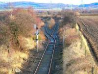 Looking east along the remains of the former Roslin branch at the south west corner of Millerhill yard in January 2007. The route was latterly used by trains serving Bilston Glen Colliery. The last train over the branch ran in 1991 [see image 36126]. <br><br>[John Furnevel&nbsp;19/01/2007]