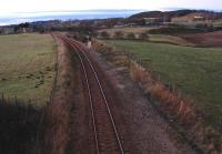 Work begins on the Raiths Farm development (new depot to replace Guild Street) with the cabling being moved to the east side of the lifted track to allow vehicles to drive up the trackbed. View looks north from the site.<br><br>[Ewan Crawford&nbsp;27/01/2007]